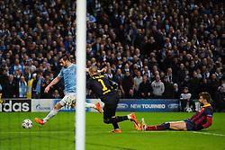 Man City Forward Alvaro Negredo (ESP) takes on Barcelona Goalkeeper Victor Valdes (ESP) in front of goal as Defender Gerard Pique (ESP) is left behind - Photo mandatory by-line: Rogan Thomson/JMP - Tel: 07966 386802 - 18/02/2014 - SPORT - FOOTBALL - Etihad Stadium, Manchester - Manchester City v Barcelona - UEFA Champions League, Round of 16, First leg.