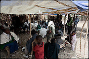 """Celebration of an early marriage, two child brides of age between 6 and 8, with to boys, 10 years largest. A baby (middle) drinks tella, a local wine, from an earthenware bowl..North West of Ethiopia, on saturday, Febrary 14 2009.....In a tangled mingling of tradition and culture, in the normal place of living, in a laid-back attitude. The background of Ethiopia's """"child brides"""", a country which has the distinction of having highest percentage in the practice of early marriages despite having a law that establishes 18 years as minimum age to get married. Celebrations that last days, their minds clouded by girls cups of tella and the unknown for the future. White bridal veil frame their faces expressive of small defenseless creatures, who at the age ranging from three to twelve years shall be given to young brides men adults already...To protect the identities of the recorded subjects names and specific places are fictional."""
