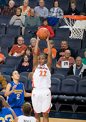 Virginia guard Monica Wright (22) grabs a rebound against Morehead State.  The Virginia Cavaliers women's basketball team defeated the Morehead State Eagles 88-43 at the John Paul Jones Arena in Charlottesville, VA on February 4, 2008.
