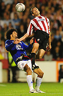 London - Tuesday, 21st September, 2010: Kevin O'Conner of Brentford and Marouane Fellani of Everton during the Carling Cup 3rd Round match at Griffin Park, London...Pic by: Alex Broadway/Focus Images