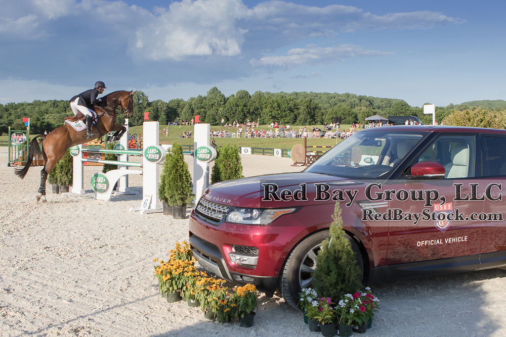 Clark Montgomery riding Loughan Glen competes in the Show Jumping phase at the 2016 Land Rover Great Meadow International on Saturday, July 9, 2016, at the Great Meadow Foundation in The Plains, VA with the 2016 Range Rover Sport in the foreground.