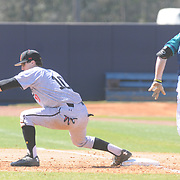 Maryland's Justin Morris forces UNCW's Casey Golden out at first Sunday March 8, 2015 at Brooks Field. (Jason A. Frizzelle)