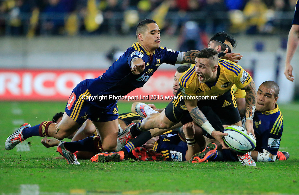 Hurricane's TJ Perenara off loads the ball.  Super Rugby Final, Hurricanes v Highlanders. Westpac Stadium, Wellington, New Zealand. 4 July 2015. Copyright Photo: John Cowpland / www.photosport.nz