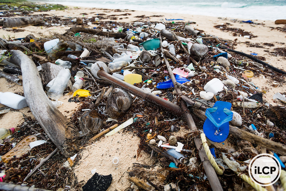 Plastic pollution on the shore in the Sian Ka'an Biosphere Reserve in southernmost Caribbean Mexico. All throughout the Caribbean plastic washes up and aggregates on the beach in dramatic quantities. This scene was not exceptional. From a 2014 iLCP (International League of Conservation Photographers) expedition project documenting the people and places of the Mexican section of the Mesoamerican Reef (MAR).