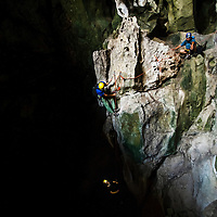 Spelunkers (cavers) descend into Mae On Cave at Crazy Horse Buttress, Chiang Mai, Thailand