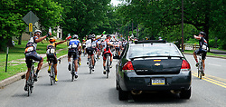 Riders ask for water refills by the supporting cars behind the peloton. Scenes from the 2011-2014 Philadelphia International Bicyling Classic #ManayunkWall Bike Race, traditionally held in the first week of June. (photo by Bastiaan Slabbers/BasSlabbers.com)<br /> <br /> For license options of Philadelphia International Cycling Classic related imagery please visit my editoiral stock portfolio at Getty Images/iStock.com: istockphoto.com/portfolio/basslabbers