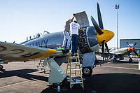 RENO, NV - SEPTEMBER 13: A flight crew prepares a plane for todays heats at the Reno Championship Air Races on September 13, 2017 in Reno, Nevada. (Photo by Jonathan Devich/Getty Images)