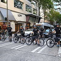 Seattle police officers are seen blocking traffic as protesters take part in a Black Lives Matter march, Saturday, August 26, 2017, in Seattle, Washington. Several thousand people attended a downtown rally and then marched through the city to call attention to minority rights and police brutality. (Alex Menendez via AP)