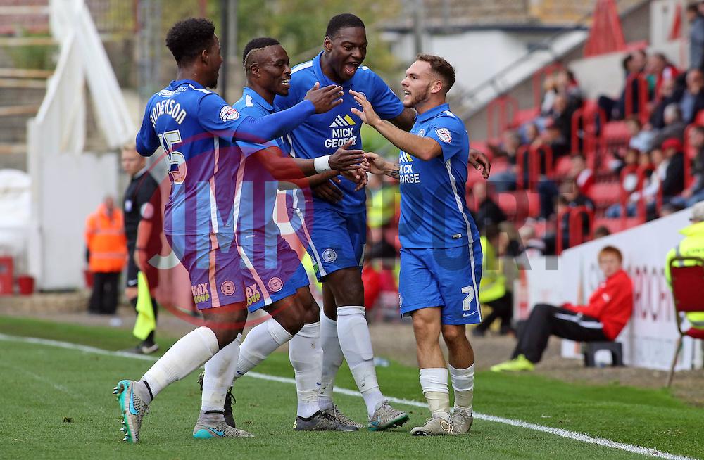 Jon Taylor of Peterborough United (right) celebrates scoring the opening goal with team-mates - Mandatory byline: Joe Dent/JMP - 07966 386802 - 10/10/2015 - FOOTBALL - County Ground - Swindon, England - Swindon Town v Peterborough United - Sky Bet League One
