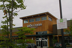 Jun 16, 2017 - Eugene, Oregon, U.S. - Exterior views of Whole Foods logo and sign. Amazon has acquired Whole Foods, a move that marks the e-commerce giant's official entry into the world of physical stores as well as groceries. It's Amazon's biggest acquisition ever, paying $13.7 billion in cash for the grocery chain, which now operates some 465 stores across the U.S. Amazon has grown into a retail behemoth and has has been tip-toeing into bookstores and experimental convenience stores. Those efforts led to speculation that Amazon eventually would make a major acquisition of a chain, rather than slowly build out its own stores. That acquisition ended up being Whole Foods. (Credit Image: ? Shalan Stewart/ZUMA Wire/ZUMAPRESS.com)