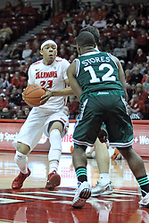 20 November 2013:  Zach Lofton brings the ball up court approaching Shane Richards and RaShawn Stores during an NCAA Non-Conference mens basketball game between theJaspers of Manhattan and the Illinois State Redbirds in Redbird Arena, Normal IL
