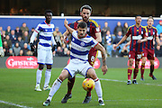 Queens Park Rangers midfielder Pawel Wszolek (15) battles for possesion with Ipswich Town midfielder Cole Skuse (8) during the EFL Sky Bet Championship match between Queens Park Rangers and Ipswich Town at the Loftus Road Stadium, London, England on 2 January 2017. Photo by Matthew Redman.