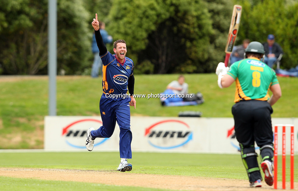 Ian Butler celebrates taking the wicket of Graham Napier.<br /> Twenty20 Cricket - HRV Cup, Otago Volts v Central Stags, 18 December 2011, University Oval, Dunedin, New Zealand.<br /> Photo: Rob Jefferies/PHOTOSPORT