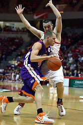 30 January 2007: Brandon Holtz guards Kyle Anslinger. The Purple Aces of Evansville folded the final 2 minutes of play and handed the game to Illinois State University Redbirds by a score of 65-61at Redbird Arena in Normal Illinois.