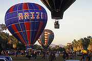 "Hot-air balloons take off from U of A Mall the morning after the annual ""Balloon Glow"" event, Tucson, Arizona..Media Usage:.Subject photograph(s) are copyrighted Edward McCain. All rights are reserved except those specifically granted by McCain Photography in writing...McCain Photography.211 S 4th Avenue.Tucson, AZ 85701-2103.(520) 623-1998.mobile: (520) 990-0999.fax: (520) 623-1190.http://www.mccainphoto.com.edward@mccainphoto.com."