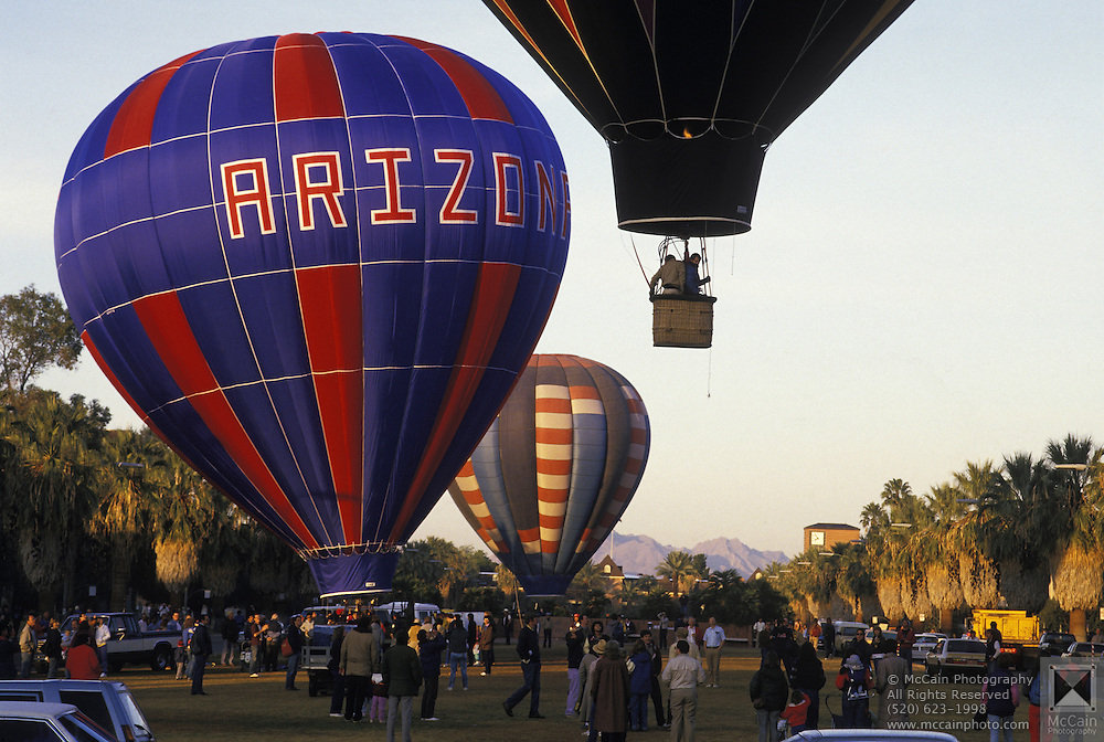 """Hot-air balloons take off from U of A Mall the morning after the annual """"Balloon Glow"""" event, Tucson, Arizona..Media Usage:.Subject photograph(s) are copyrighted Edward McCain. All rights are reserved except those specifically granted by McCain Photography in writing...McCain Photography.211 S 4th Avenue.Tucson, AZ 85701-2103.(520) 623-1998.mobile: (520) 990-0999.fax: (520) 623-1190.http://www.mccainphoto.com.edward@mccainphoto.com."""