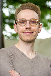 "Pictured: Daniel Tammet FRSA is an English essayist, novelist, translator, and autistic savant. His 2006 memoir, Born on a Blue Day, about his life with Asperger syndrome and savant syndrome, was named a ""Best Book for Young Adults"" in 2008 by the American Library Association Young Adult Library Services magazine<br /> <br /> Book fanatics headed to Charlotte Square in Edinburgh which is the hub of the international Book Festival to meet the authors and also to meet up with fellow fans of the printed word.<br /> <br /> 25 August 2017"