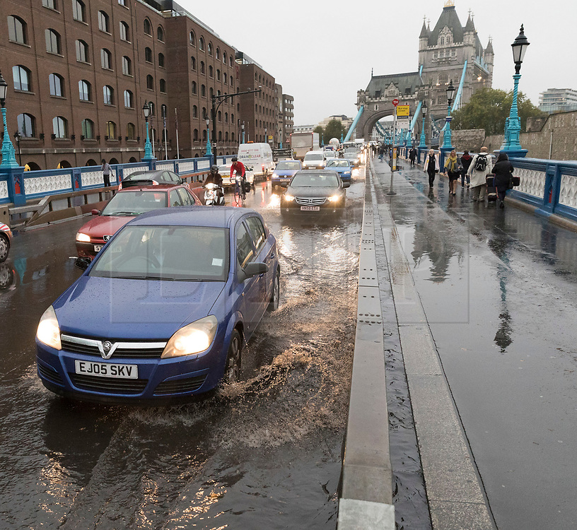 © Licensed to London News Pictures. 15/10/2018. London, UK.  Flooding and excess surface water on Tower Bridge road in London following heavy rain in the capital yesterday and overnight. Storm Callum has brought torrential rain and flooding to many parts of the UK..  Photo credit: Vickie Flores/LNP