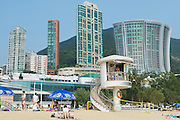 HONG KONG, CHINA - SEPTEMBER 16, 2012: Unidentified people relax at Stanley town beach in Hong Kong, China. Stanley town is a tourist attraction in Hong Kong.
