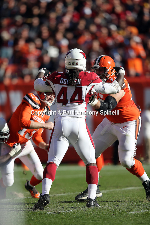 Arizona Cardinals outside linebacker Markus Golden (44) gets blocked as he rushes the quarterback during the 2015 week 8 regular season NFL football game against the Cleveland Browns on Sunday, Nov. 1, 2015 in Cleveland. The Cardinals won the game 34-20. (©Paul Anthony Spinelli)