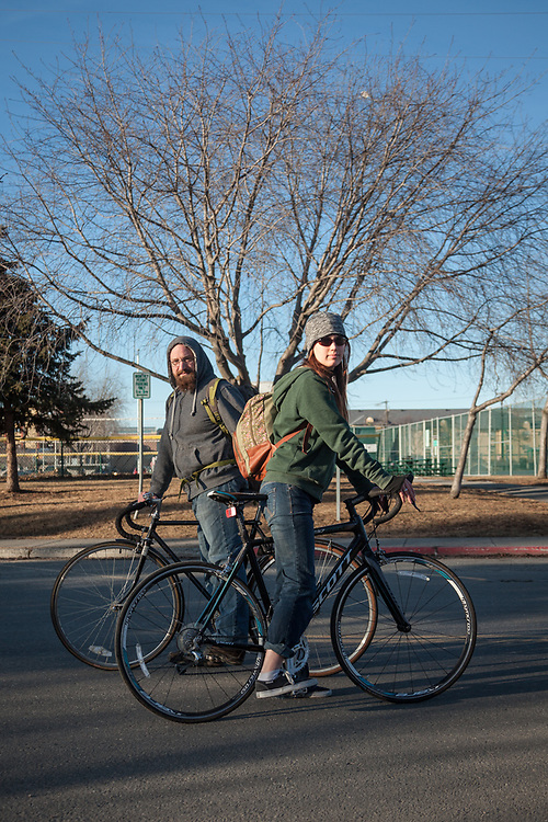 "Wesley Ann Foraker and Tim Hartmann on 10 Avenue and on their way home from a day's work at Title Wave Books in Anchorage.  ""We're getting married in June…our future plans are a bit scattered.""  winterspren@gmail.com"
