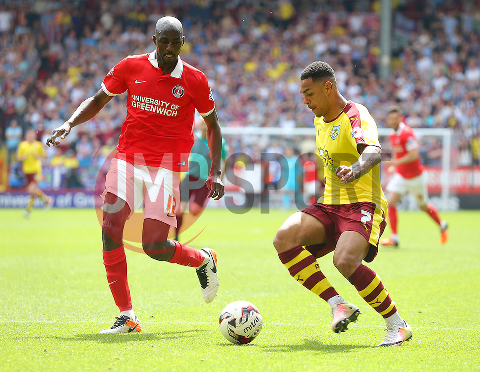 Alou Diarra of Charlton Athletic and Andre Gray of Burnley challenge for the ball - Mandatory by-line: Paul Terry/JMP - 07/05/2016 - FOOTBALL - The Valley - London, England - Charlton Athletic v Burnley - Sky Bet Championship