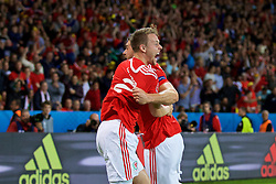 LILLE, FRANCE - Friday, July 1, 2016: Wales' Sam Vokes celebrates scoring the third goal against Belgium, to seal a 3-1 victory, with team-mate Chris Gunter during the UEFA Euro 2016 Championship Quarter-Final match at the Stade Pierre Mauroy. (Pic by David Rawcliffe/Propaganda)