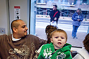 27 DECEMBER 2008 -- PHOENIX, AZ: At 10:12AM Mario Campa (LEFT) and his son Mario Xavier Campa and Mario's mom, Jamie Bottjer ride the light rail out of Phoenix. They are from Chandler and he worked on the plumbing in the new convention center. Metro Light Rail started running Saturday, Dec. 28.  The light rail line is 20 miles long and cost $1.4 billion dollars. PHOTO BY JACK KURTZ
