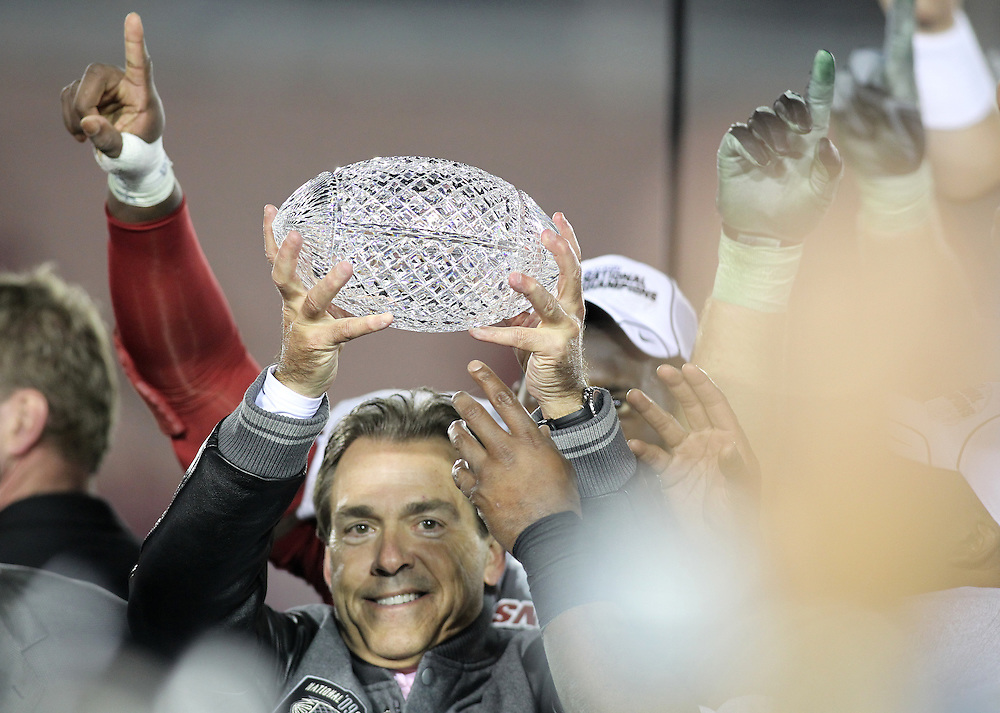 PASADENA,CA - JANUARY 07:  Head Coach Nick Saban of the Alabama Crimson Tide holds the coaches trophy. The Alabama Crimson Tide's victory over Texas Longhorns 37-21 in the BCS National Championship game on January 7, 2010 at the Rose Bowl in Pasadena, CA. Photo by Tom Hauck.