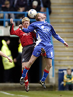 Photo: Olly Greenwood.<br />Gillingham v Swansea City. Coca Cola League 1. 25/03/2006. Swansea's Alan Tate (L) and Gillinham's Gary Mulligan battle.