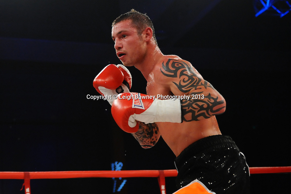 Garry Neale (pictured) defeats Simas Volosinas in a Light Welter weight contest. Glow, Bluewater, Kent, UK. Hennessy Sports © Leigh Dawney Photography 2013.