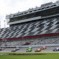 Gen6 race cars are seen on the front stretch during the NASCAR Coke Zero 400 Sprint practice session at the Daytona International Speedway on Thursday, July 4, 2013 in Daytona Beach, Florida.  (AP Photo/Alex Menendez)