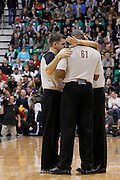 Officials confer during an NBA basketball game in Salt Lake City, Wednesday Jan. 12, 2011. (AP Photo/Colin E Braley)
