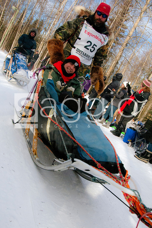 Musher Tom Thurston and Iditarider Aaron Meyer ride along the Chester Creek Trail During the 2011 Iditarod Ceremonial Start.