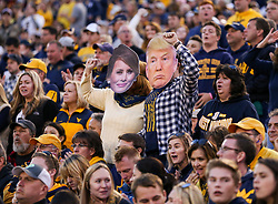 Nov 4, 2017; Morgantown, WV, USA; West Virginia Mountaineers fans impersonate President Donald Trump and first lady Melania Trump during the third quarter against the Iowa State Cyclones at Milan Puskar Stadium. Mandatory Credit: Ben Queen-USA TODAY Sports