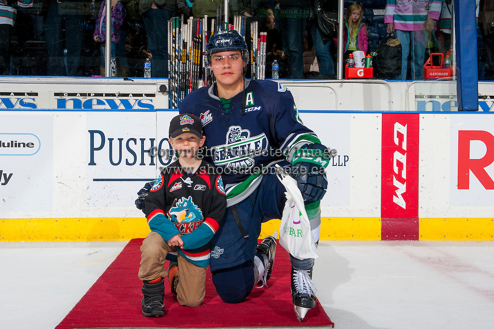KELOWNA, CANADA - FEBRUARY 13: Ethan Bear #25 of the Seattle Thunderbirds accepts the third star of the game against the Kelowna Rockets on February 13, 2017 at Prospera Place in Kelowna, British Columbia, Canada.  (Photo by Marissa Baecker/Shoot the Breeze)  *** Local Caption ***