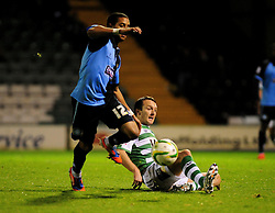 Yeovil Town's Gavin Williams challenges Wycombe Wanderers' Bruno Andrade - Photo mandatory by-line: Dougie Allward/JMP  - Tel: Mobile:07966 386802 04/12/2012 - SPORT - FOOTBALL - Johnstone's Paint Trophy  -  Yeovil  -  Huish Park  -  Yeovil Town V Wycombe Wanderers