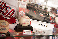 Angels Super Fan Rob Rohm, of Orange, is quite the dedicated Halos fan. Signed balls, helmets, bats, banners, and tickets, among many others, adorn every inch of his man cave. <br /> <br /> ///ADDITIONAL INFO:   <br /> <br /> angels.superfan.06xx.kjs  ---  Photo by KEVIN SULLIVAN / Orange County Register  -- 6/8/16<br /> <br /> Angels Super Fan Rob Rohm is quite the dedicated Halos fan. Signed balls, helmets, bats, banners, and tickets, among many others, adorn every inch of his man cave. These are not just random items. Name almost any recent significant Angels memory and Rohm has a piece of it. Garret Anderson's 10-RBI game? Yup. Second base from Game 6 of the 2002 ALCS? Yup. Game used bats from almost every starter from that World Championship team? Nolan Ryan signed everything? THE State Farm sponsored backstop from the 2010 All-Star game at the Big A? Yup, yup, and yup. Used as the bar, it even has a photo of Home-run Derby winner David Ortiz on top it.