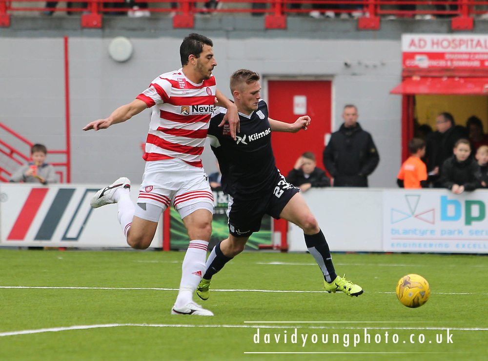 Dundee's Rhys Healey tries to get away from Hamilton Academical's Lucas Tagliapietra - Hamilton Academical v Dundee, Ladbrokes Premiership at New Douglas Park<br /> <br /> <br />  - &copy; David Young - www.davidyoungphoto.co.uk - email: davidyoungphoto@gmail.com