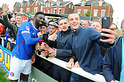 Jabo Ibehre (14) of Carlisle United celebrates his teams 3-2 win over Exeter at full time with a selfie with the travelling fans during the EFL Sky Bet League 2 match between Exeter City and Carlisle United at St James' Park, Exeter, England on 6 May 2017. Photo by Graham Hunt.
