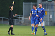 FC Halifax Town midfielder Josh Staunton (6)  is shown a yellow card by the referee  Rebecca Welch  during the Vanarama National League match between FC Halifax Town and Dover Athletic at the Shay, Halifax, United Kingdom on 17 November 2018.