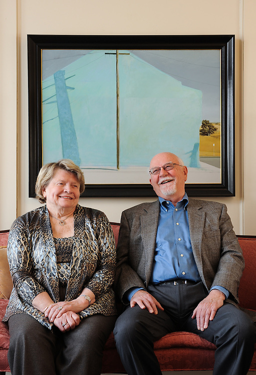 Senior couple enjoying a laugh at their home as part of an editorial lifestyle photo shoot in Dallas.