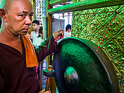 18 NOVEMBER 2017 - YANGON, MYANMAR: A man bangs a prayer gong at Botataung Pagoda in Yangon. Pope Francis is visiting Myanmar, September 27-30. It will be the first visit by a Pope to the overwhelmingly Buddhist nation. He will meet with the Aung San Suu Kyi and other political leaders and will participate in two masses in Yangon. The Pope is expected to talk about Rohingya issue while he is in Myanmar. The Rohingya are persecuted Muslim minority in Rakhine state in western Myanmar. It's not clear how Myanmar's politically powerful nationalist monks will react if the Pope openly talks about the Rohingya. In the past, the monks have led marches and demonstrations against foreign diplomatic missions when foreign ambassadors have spoken in defense of the Rohingya. There is not much visible sign of the Pope's imminent visit in Yangon, which is estimated to be more than 90% Buddhist.    PHOTO BY JACK KURTZ