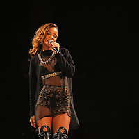 "ST PAUL, MN - MARCH 24:  Rihanna performs during her ""Diamonds"" world tour at Xcel Energy Center on March 24, 2013 in St. Paul, Minnesota. (Photo by Adam Bettcher/Getty Images) *** Local Caption *** Rihanna"