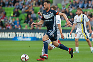 Melbourne Victory midfielder Carl Valeri (21) runs the ball at the Hyundai A-League Round 4 soccer match between Melbourne Victory and Central Coast Mariners at AAMI Park in Melbourne.