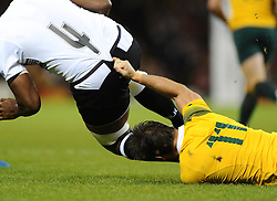 Australia Winger Rob Horne attempts to tackle Fiji Lock Tevita Cavubati with his small finger  - Mandatory byline: Joe Meredith/JMP - 07966386802 - 23/09/2015 - Rugby Union, World Cup - Millenium Stadium -Cardiff,Wales - Australia v Fiji - Rugby World Cup 2015 - Pool A