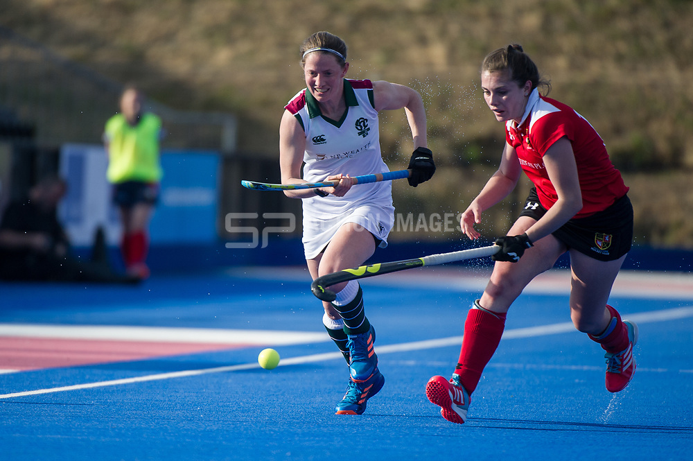 Surbiton's Rebecca Middleton is tackled by Harriet Pittard of Holcombe. Holcombe v Surbiton - Investec Women's Hockey League Final, Lee Valley Hockey & Tennis Centre, London, UK on 23 April 2017. Photo: Simon Parker
