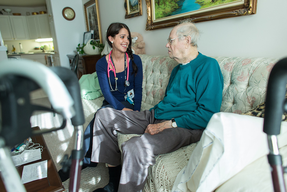 Strathroy, Ontario ---2015-05-13--- Becky Rutherford, a palliative care nurse with the VON Palliative Care Team talks with Phillip McDonnell during a visit to his apartment in Strathroy, Ontario, May 13, 2015.<br /> GEOFF ROBINS The Globe and Mail