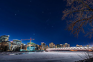 Orion and the winter stars, including Sirius and Procyon, on a clear winter night in downtown Calgary and shining over the pedestrian Peace Bridge over the Bow River. I shot this on January 20, 2018. <br /> <br /> This is a real scene, though the sky is a single longer exposure of 13 seconds, while the ground is a blend of 4 exposures from 2 to 8 seconds, all at ISO 100 and f/2.8 with the 14mm Sigma Art lens and Nikon D750. No light pollution reduction filter was used here, as none fit over the large lens of the 14.<br /> <br /> The ground images were blended with luminosity masks generated with ADP Pro v3, to prevent the lights on the bridge from blowing out too much. <br /> <br /> Star diffraction spikes added with Astronomy Tools actions.