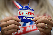"Barbara Ebright of Milpitas holds a ""Esteves for Mayor"" pin during the Mayor Jose Esteves party in Milpitas, California, on November 4, 2014. (Stan Olszewski/SOSKIphoto)"
